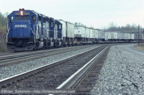 Conrail eastward Trailvan stopped outside of Buffalo waiting for a clear signal. Leica M2 with 200mm Telyt lens.