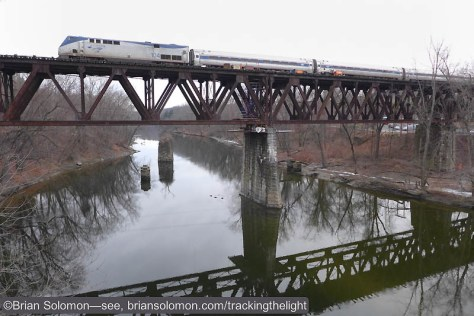 Amtrak's special crosses the Deerfield River on the Cheapside Bridge. Back in the day there was a canal harbor near here. Lumix LX7 photo, December 22, 2014.