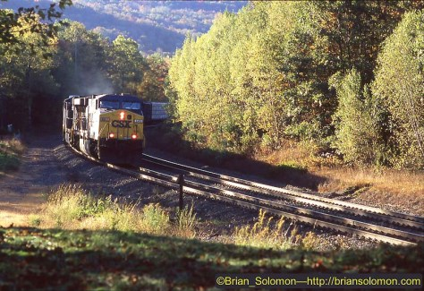 Autumn on the Boston & Albany in the Berkshires of Massachusetts. An eastward CSX freight descends Washington Hill at the old Middlefield station-location on October 7, 2004.