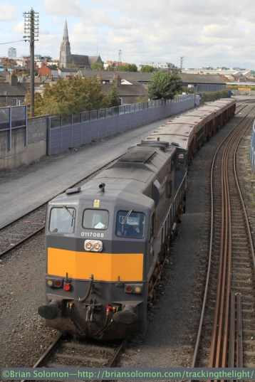 A laden Tara Mines train arrives at the North Wall. This will continue into Dublin port on street trackage on the Alexandra Road. Canon EOS 7D photo.