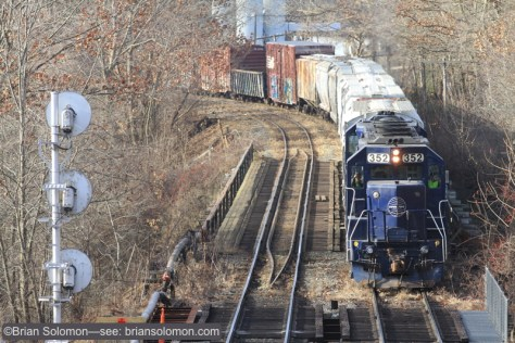 I made this tighter view, while intentionally offsetting the freight to feature the old searchlight style signal on the left. These old signals are rapidly being replaced with modern hardware. Canon EOS 7D with 200mm lens.