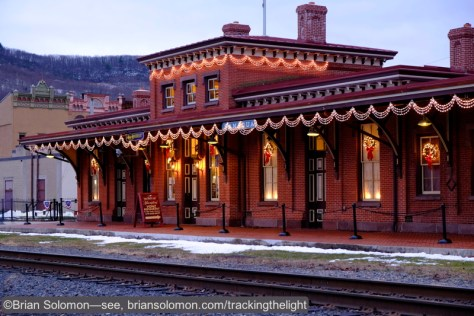 I positioned Pat Yough's X-T1 on a tripod and waited for dusk—one of my favorite times to photograph old railway stations. Tamaqua's classic Italianate style structure was decorated for the season. Daylight white balance.