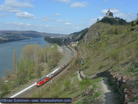 A southward DB freight rumbles along the Rhein. Exposed near Braubach on April 10, 2010 using my Lumix LX3. This photograph require a nominal walk from road level up the footpath seen in the foreground. Somewhere down there is the hired car and some friends from Ireland.