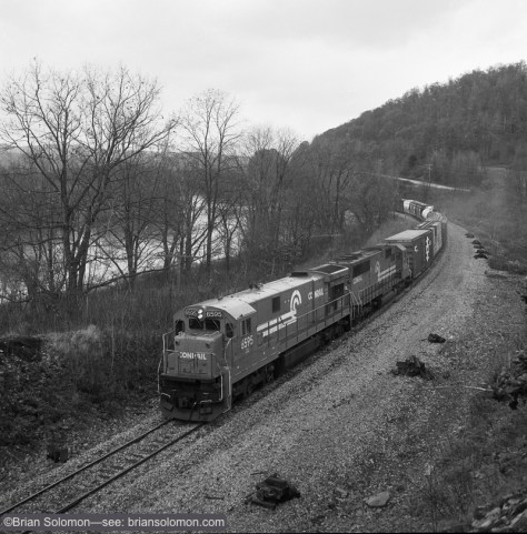 Conrail C30-7A 6595 leads ELOI eastbound along the Allegheny River west of Allegany, New York at 11:58am on November 6, 1988. Exposed on ISO 400 Kodak Tri-X with a Rollei Model T with 75mm Zeiss Tessar, f5.6 1/250th of a second.