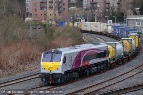 At 1:51pm on Saturday, February 28, 2015, Enterprise locomotive 206 wearing fresh paint approaches Islandbridge Junction near Hueston Station in Dublin. Exposed with a Fuji X-T1.