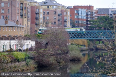 On February 9, 2015, I made this view of an Irish Rail class 201 crossing the River Liffey. The 18-135mm lens was fully extended to its most extreme telephoto position. Heavy overcast require me to boost the ISO setting to 1000.