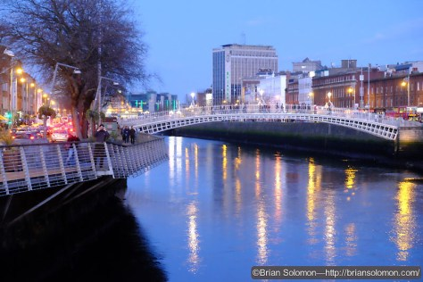 Dublin's iconic Ha'Penny Bridge at dusk. Exposed using a Fujifilm X-T1 mirrorless digital camera fitted with an 18-135mm zoom lens.