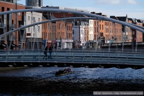 James Joyce Bridge with boat on Liffey. Fuji X-T1 photo.