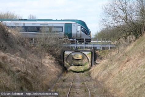 Dublin bound Irish Rail ICR (Intercity Railcar) crosses the Bord na Mona 3-foot gauge near Portlaoise. Fuji X-T1 photo.