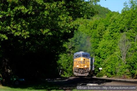 An eastward CSX intermodal train, probably Q012, approaches Warren. Exposed with a Fujifilm XT1 digital camera.