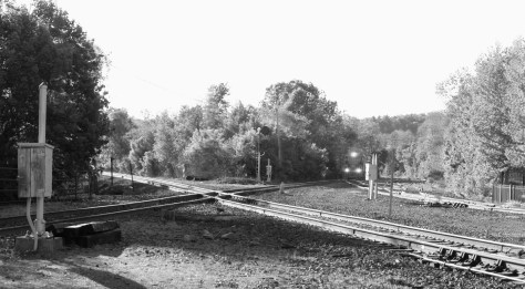 A tightly cropped view showing the New England Central-CSX diamond crossing.