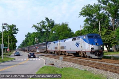 Amtrak number 53, Exposed with a Fujifilm X-T1 with 18-135mm lens set to 34mm . Notice the unusual grade crossing signal with the bracket arm.