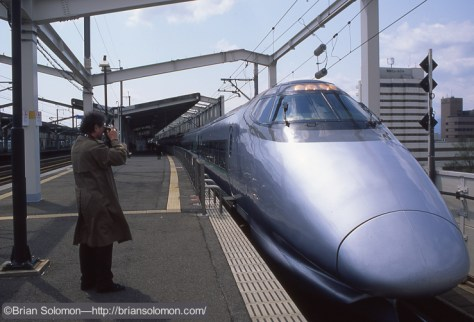 Richard Jay Solomon makes a photograph of a Series 400 Shinkansen train on the platform at Fukushima, Japan on April 19, 1997. Exposed on Fujichrome film.
