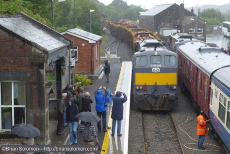 084 with a laden timber train at Westport.