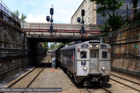 Stainless steel multiple-unit glide into the station at Summit. Today many trains through Summit go to Penn-Station, New York rather than Hoboken.