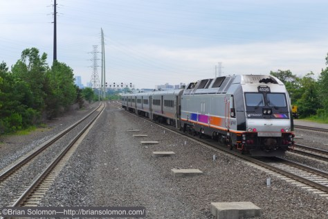 A train from Suffern, New York to Hoboken accelerates away from Secaucus. Lumix LX7 photo.