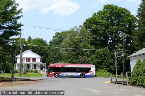 PVTA bus crosses the old Central Vermont at Amherst, Massachusetts.
