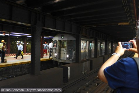 Photographing the J train.