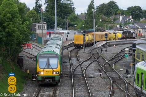 A Dublin-bound set of 29000 railcars in the new livery has just departed the station.