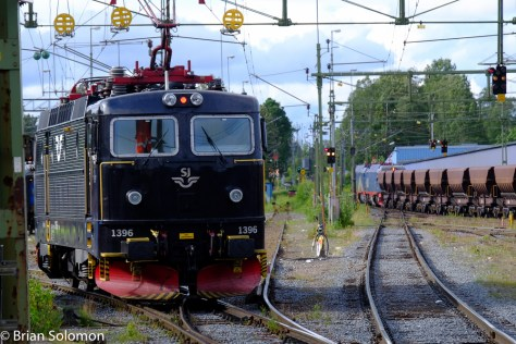 An Rc6 works the coach yard as the empty ore train heads northward to beyond the Arctic Circle.