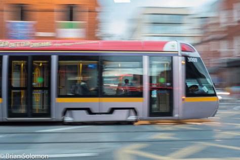 LUAS 3001 crosses Queen Street, Dublin. 17 September 2015. Lumix LX7 photo.