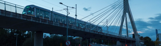 LUAS at Dusk—Silvery Trams in Silhouette