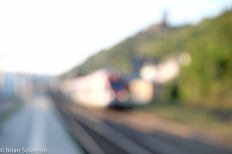 Another example of a Stadler Flirt photo gone amiss: The bright white train momentarily confused the autofocus system on my FujiFilm X-T1. Instead of selecting an appropriate focus point, the system was  hunting for focus when I released the shutter. The result is totally out of focus. Compare the effect of being out focus with that of the above image, which is suffering from motion blur. These are distinct characteristics. While I often use selective focus and motion blur to positive advantage, here they've ruined other wise fine images. If you want to see nicer photos of Stadler Flirts, I featured these in a post last week. See: http://wp.me/p2BVuC-3f7