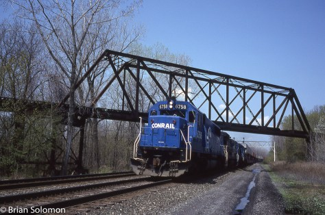 Conrail SD50 leads symbol freight PXSE (Pacific Express to Selkirk, New York) eastward on the number 1 track at CP342 near Newark, New York.