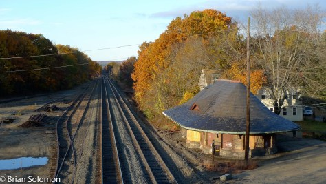 This photo of the East Brookfield station was one of the first images I made with my new Panasonic LX3 digital camera. I was testing the camera (which I'd bought to use as a light meter) on an bright October morning in 2009. There were two eastward CSXT freights coming and I was trying to gauge the light. CSXT had just recently put a new roof on the old building. Less than a year after I made this view it succumbed to fire. This photo is reproduced  on page 83 of my book.