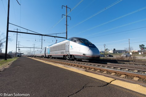Who said you can't use a wide-angle when photographing a high-speed train. Acela Express 2250 was racing along at an estimated 125 mph when I exposed this view with my FujiFilm X-T1 digital image with Zeiss 12mm Touit lens. I had the camera in 'CF' (Continuous Fast, what I call 'turbo flutter') and the shutter speed at 1/2000th of a second.