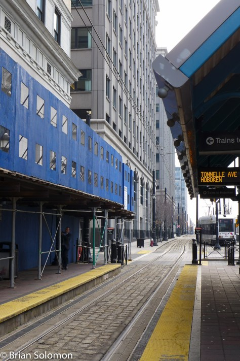 Exchange Place in December 2015: Perhaps after the renovation work on the bank building (at left) has been completed, I'll come back and make another view.