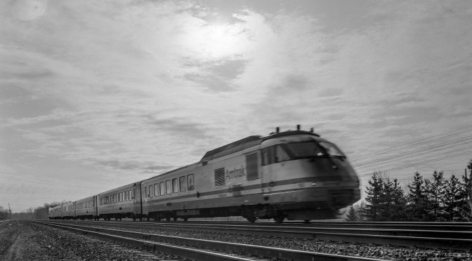 Sun and Clouds and a Turbo Train Near Rochester, New York.