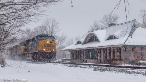 CSX Q264 passes the old Boston & Albany station at Warren, Massachusetts.