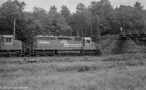 Conrail eastward freight at Bullards Road, Hinsdale, Massachusetts on August 3, 1984. Take notice the former Erie Lackawanna SD45-2, Conrail 6659, second out. Some of those old EMD's are still on the move too. This day it's 20-cylinder 645-diesel was adding to atmosphere. (Fear not, I have plenty of photos of the SD45-2s on the B&A and elsewhere on Conrail).