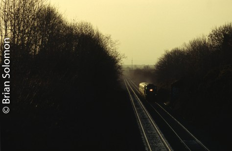 Before the headlight came into view, I could hear the 12-cylinder 645 diesel roaring away. Here an 071 is in 'run-8' (maximum throttle) as it leads a short Mark2 set from Limerick up Ballybrophy Bank on its way to Dublin. I made this vignette on 9 December 2006. Such scenes would soon be a memory.