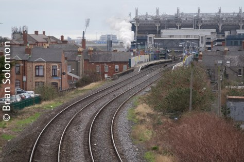 A wisp of steam hints at some excitement; I made this view Looking toward Drumcondra Station and Dublin's Croke Park on the morning of 13 March 2016.