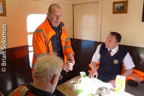 Discussing logistics in the crew van.