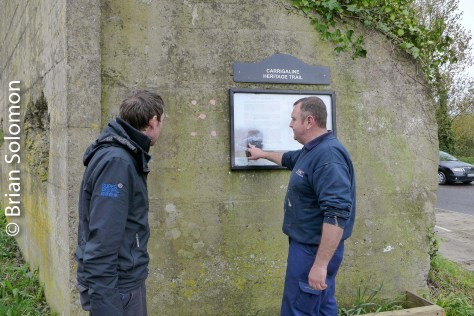 Ken Fox studies a sign illustrating the history of the Cork, Blackrock & Passage.