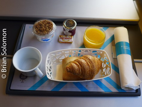 In 1980, my brother was the first to photograph his meal (served on a World Airways DC-10). I'm following his example and not that of the millions of copycats.