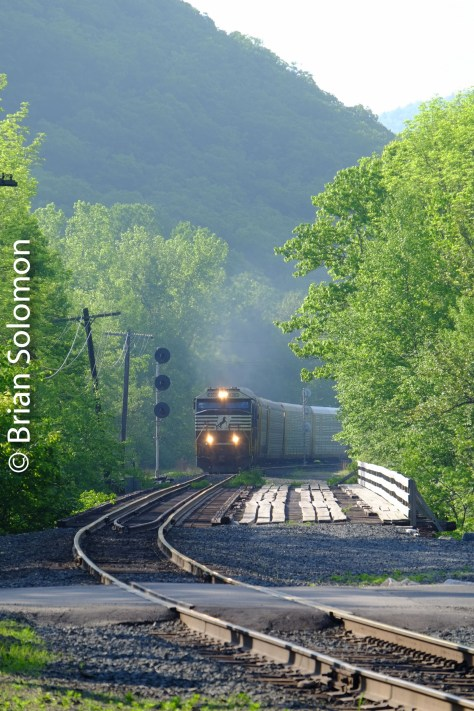 I heard a whistle deep in the valley to the east. Curiously, this was a second empty auto rack train that was overtaking the train I'd photographed earlier. In the lead was Norfolk Southern 6900 which features a modern variation of the Safety cab. Exposed with my FujiFilm X-T1 at East Portal.