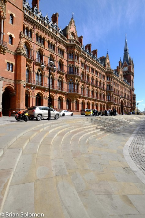 The most elegant and ornate London terminus is St. Pancras. The head house originally served as the Midland Grand Hotel as well as booking offices. Today the grand old building is again a hotel, while the station serves Eurostar trains to Paris, Lille and Brussels as well as domestic services using the old Midland route. FujiFilm X-T1 photo with Zeiss 12mm lens, May 2016.