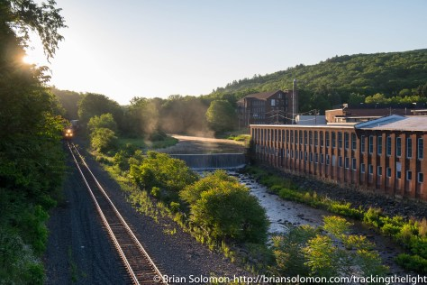 Sunrise at West Warren, Massachusetts. CSX's Q-019 has just entered the scene. For me the mist on the river adds a delicious element. June 2016.