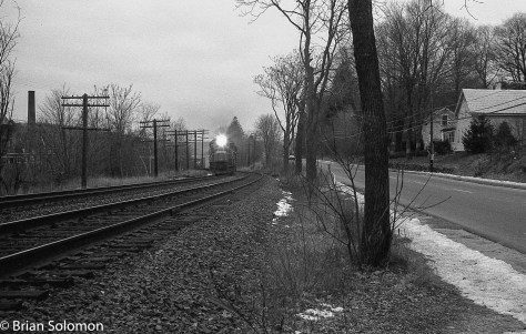Conrail eastward freight grinds upgrade on a dull March 1984 morning. Exposed on black & white film using a Leica 3A with 50mm Summicron lens.
