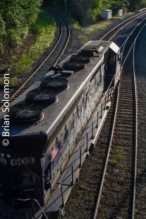 Pan Am 603 catches the glint at East Deerfield, Massachusetts on this day (July 30) three years ago (2013). Canon 7D image adjusted in Lightroom to reduce contrast.