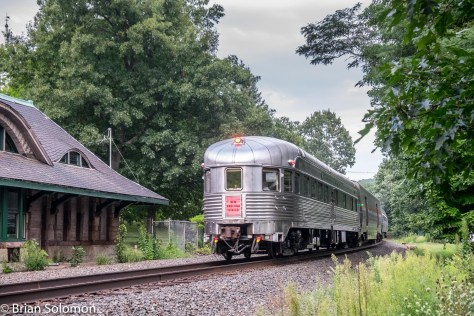 New York Central Babbling Brook passes the old Warren, Massachusetts station on August 25, 2016. The New York Central System leased the Boston & Albany in 1900. Central's Budd-built New England States Limited was B&A's premier post-war passenger train and passed Warren daily. There were fewer line-side trees back then. This image was adjusted in post-processing using Light Room. I've tried to emulate the contrast and color palate of a late 1940s image.