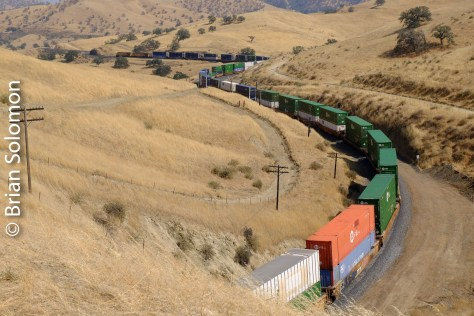 Like a long snake, the train winds its way uphill toward Tehachapi Summit.