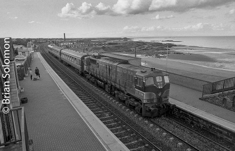 Irish Rail class 071 General Motors diesel number 078 leads a pair of Cravens plus gen-van at Balbriggan in August 1998. Exposed on 35mm black & white film using a Nikon F2 (on a long-term loan from Brian Jennison) and Nikkor 24mm lens with yellow filter. Film processed in ID11, and image adjusted for exposure and contrast in Lightroom.