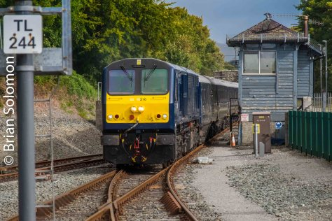Belmont's Grand Hibernian arrives at Killarney, passing the old signal cabin.