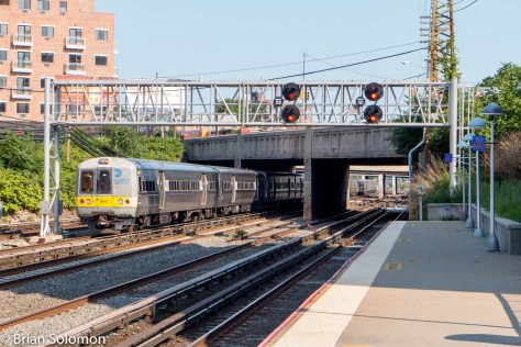 One of LIRR's older Metropolitan-series trains is heading toward Penn-Station.