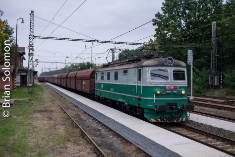 5:14pm an electric in one of the older CD liveries leads a coal train eastbound.